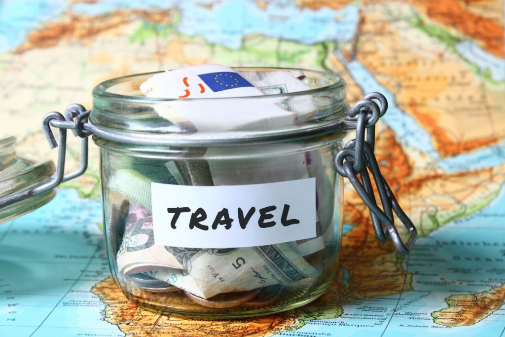 jar with money labeled as travel